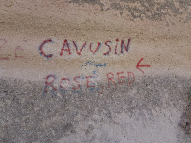 Trail sign. Red Valley, Rose Valley, and Cavusin town.