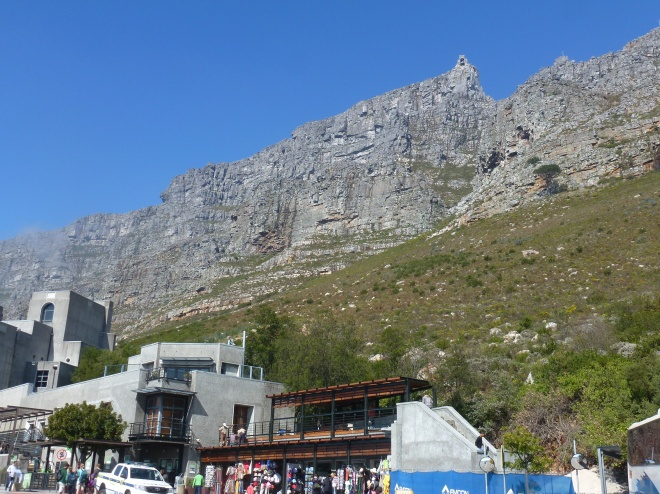 The hike begins. The two funicular stations showing at the base and the summit