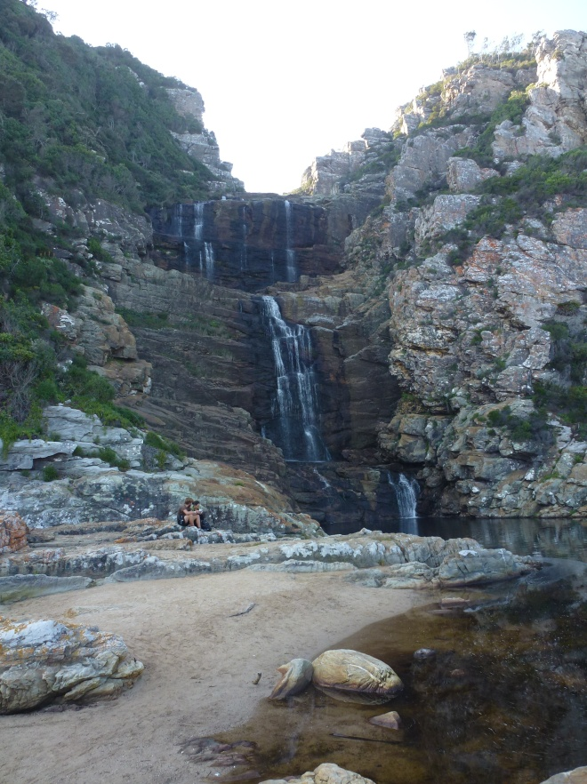 The waterfall. For scale, check the picnickers at the base on the left.