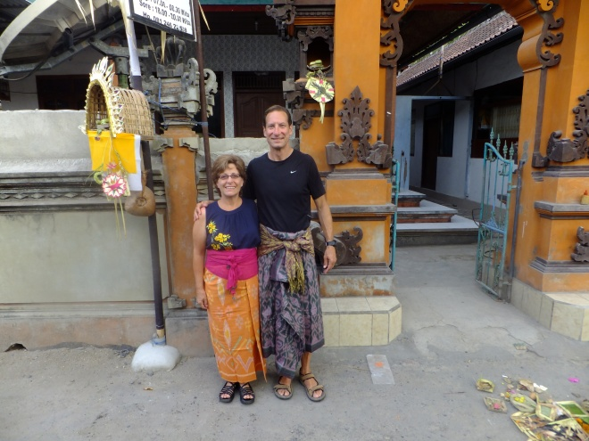 In our rented sarongs on the way to a local ceremony  for Kuningan