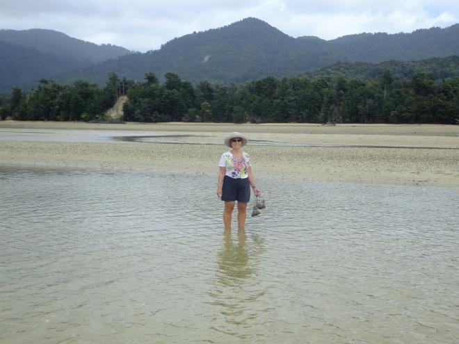 Crossing Aowara Inlet at low tide
