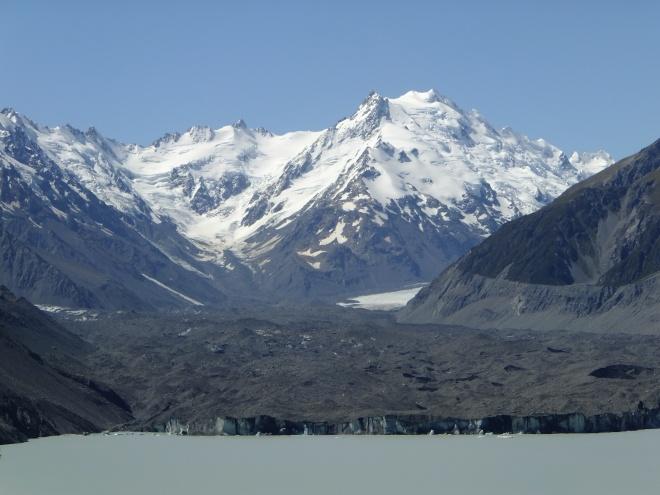 Tasman Glacier Lake laps at the terminus of Tasman Glacier (foreground)