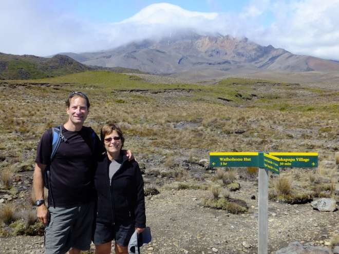 In front of cloud-capped volcano, Mt. Ngauruhoe
