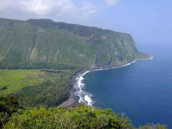 The Wipi'o Valley meets the Pacific Ocean in a dramatic locale