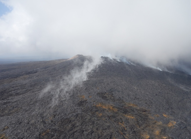 Molten hot lava flows on Kilauea (bottom right)