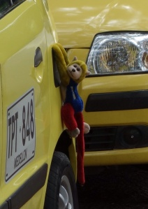 taxi with monkey hanging