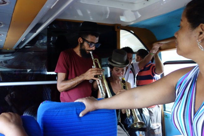 Funky trumpet-playing duet entertaining us on a bus