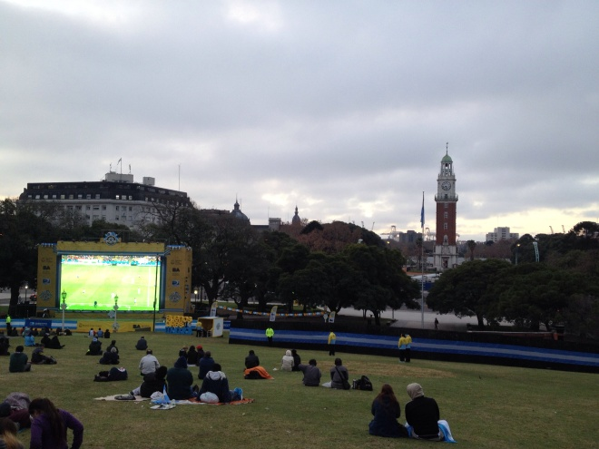 San Martin square; giant  tv for public futbol viewing;  English Tower in the background